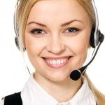 Cheerful professional call center operator, white background